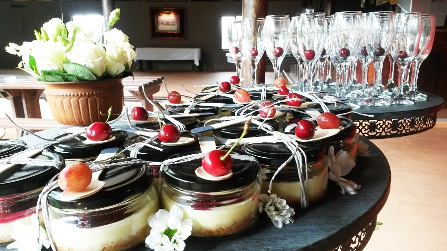 Cheesecake in a jar with berry compote and champagne