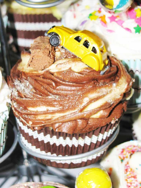 Toy cars on cupcakes